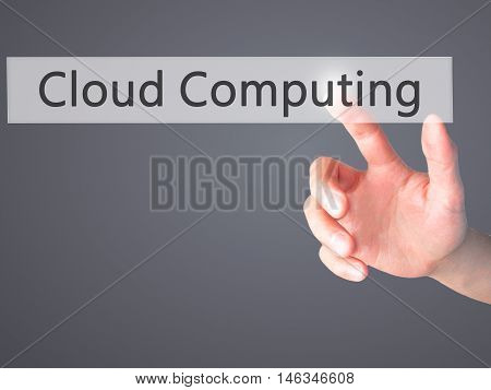 Cloud Computing - Hand Pressing A Button On Blurred Background Concept On Visual Screen.