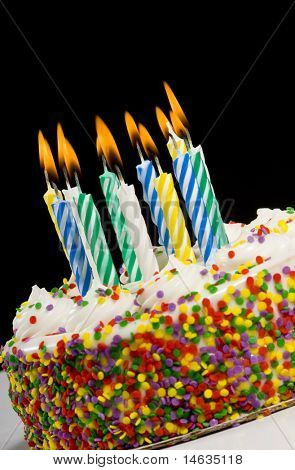 A colorful birthday cake with candles