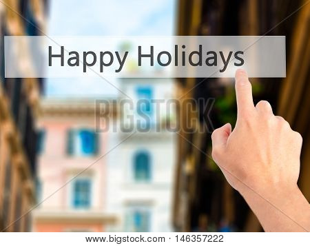 Happy Holidays - Hand Pressing A Button On Blurred Background Concept On Visual Screen.