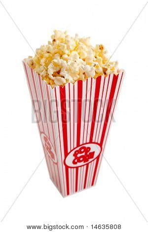 A red and white popcorn container filled with popcorn on a white background
