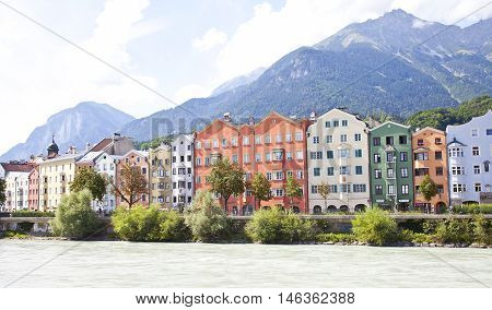 INNSBRUCK AUSTRIA - AUGUST 19 2016: Colorful architecture of houses of Innsbruck Austria. Innsbruck is the capital city of the federal state of Tyrol (Tirol)