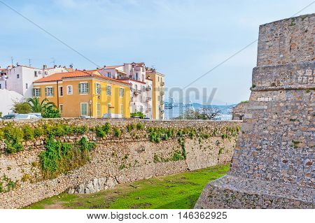 The rampart of the old Citadel surrounded the colorful residential buildings and located adjacent to the port Ajaccio Corsica France.