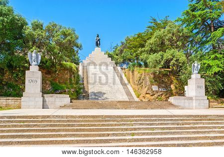 AJACCIO FRANCE - MAY 2 2013: The memorial complex of Napoleon Bonaparte in Place d'Austerlitz the statue of Emperor atop the tall stairway on May 2 in Ajaccio.