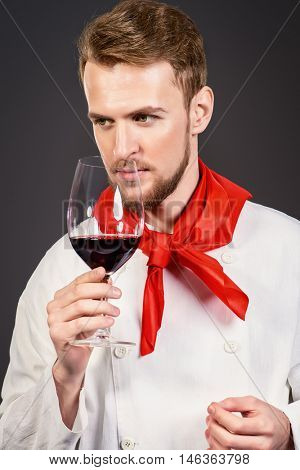Male sommelier tasting red wine. Winemaking. Occupations.