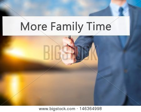 More Family Time - Businessman Hand Holding Sign