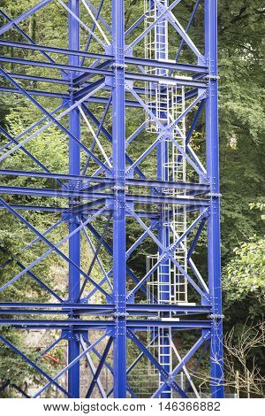 metal structure with safety ladder in the wood