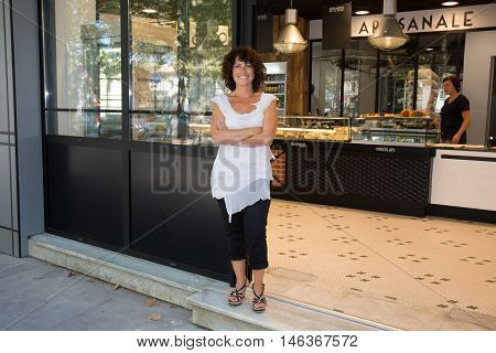 Beautiful Small Business Bakery Shop Owner Standing In Her Shop.