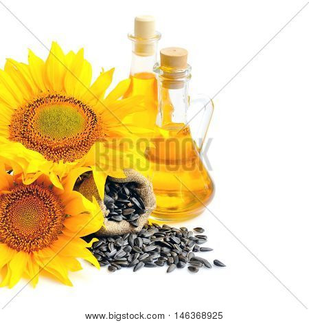 Small Bag With Sunflower Seeds And Flowers And A Bottle Of Sunflower Oil