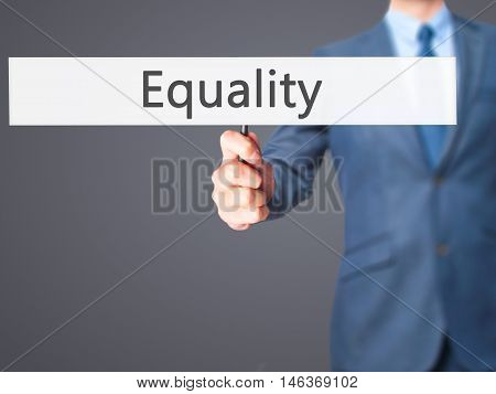 Equality - Businessman Hand Holding Sign