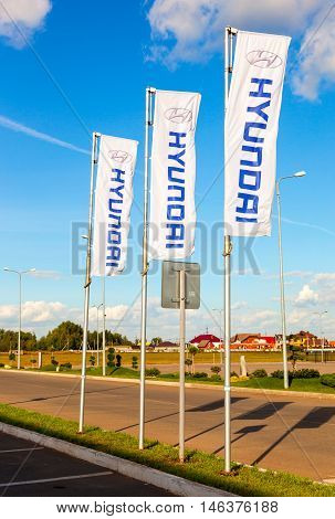 SAMARA RUSSIA - AUGUST 27 2016: The flags of Hyundai over blue sky. The Hyundai Motor Company is a South Korean multinational automotive manufacturer headquartered in Seoul South Korea