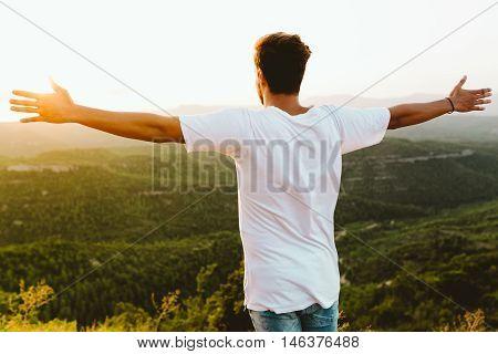 Handsome Young Man Enjoying Nature At Mountain Peak.