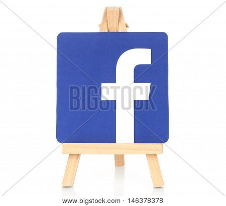 Kiev Ukraine - August 30 2016: Facebook logo printed on paper and placed on wooden easel. Facebook is a well-known social networking service