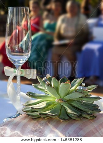 prepared accessories for wedding ceremony with glass