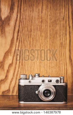 Vintage camera on wooden background. Close up.