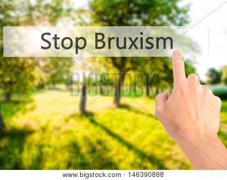 Stop Bruxism - Hand Pressing A Button On Blurred Background Concept On Visual Screen.