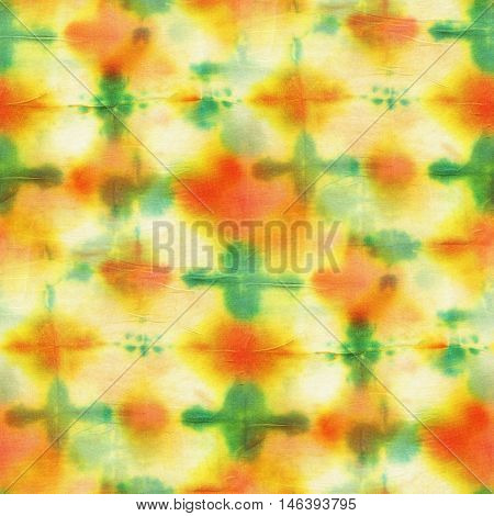 Seamless tie-dye pattern of red and green color on white silk. Hand painting fabrics - nodular batik. Shibori dyeing.