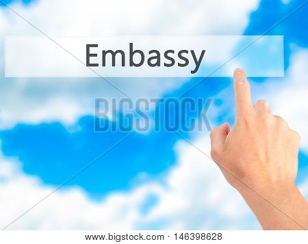 Embassy - Hand Pressing A Button On Blurred Background Concept On Visual Screen.