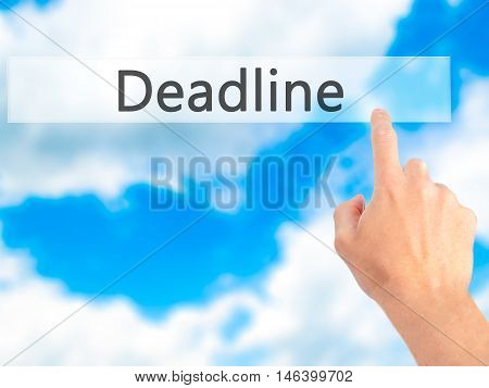 Deadline - Hand Pressing A Button On Blurred Background Concept On Visual Screen.