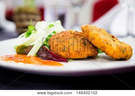 lovely plate of fishcakes in a stylish restaurant
