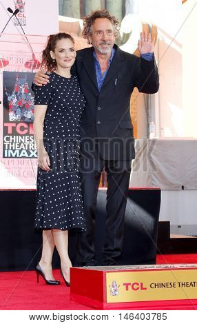Winona Ryder and Tim Burton at the Tim Burton Hand And Footprint Ceremony held at the TCL Chinese Theater in Hollywood, USA on September 8, 2016.
