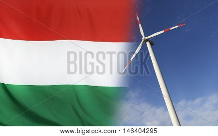 Concept clean energy with flag of Hungary merged with wind turbine in a blue sunny sky
