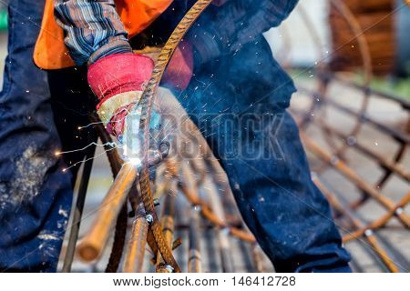 Close Up Of The Hands Welder Worker With Electrode