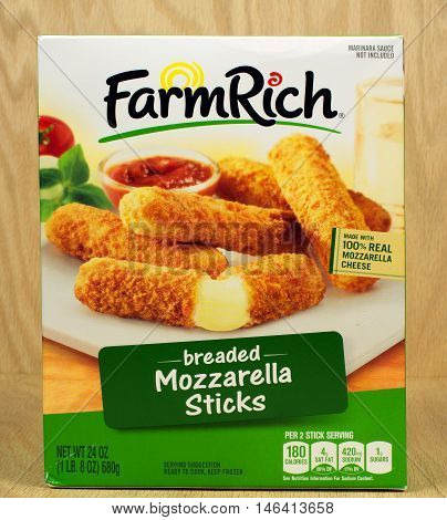 RIVER FALLS,WISCONSIN-SEPTEMBER 09,2016: A box of FarmRich brand breaded mozzarella sticks against a wood background.