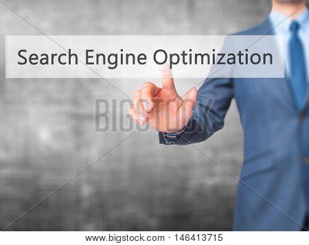 Search Engine Optimization -  Businessman Press On Digital Screen.