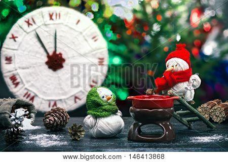 Yarn Snowmen On The Table