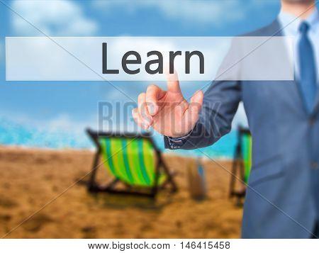 Learn -  Businessman Press On Digital Screen.