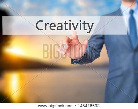 Creativity -  Businessman Press On Digital Screen.