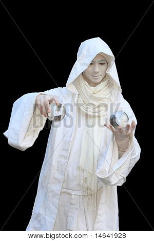 White Wizard manipulating crystal balls  isolated on black background.