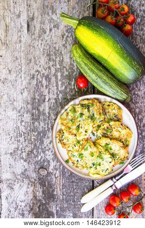 Squash And Zucchini Fritters On Old Wooden Table