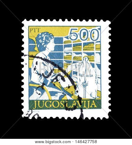 YUGOSLAVIA - CIRCA 1986 : Cancelled postage stamp printed by Yugoslavia, that shows Postal employee sorting mail.