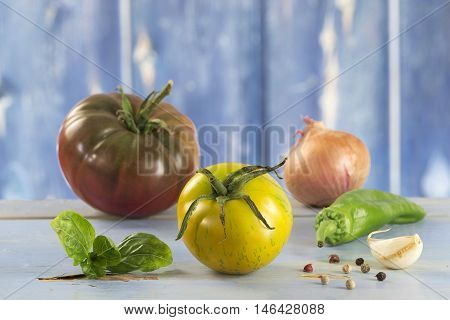 Heirloom tomatoes and basil leaves and spices