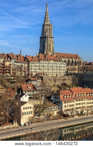 Bern, Switzerland - 29 December, 2015: buildings along the Aare river and the Bern Minster - view from the Kirchenfeld bridge. The city of Bern is the capital of Switzerland and the fourth most populous city in the country.