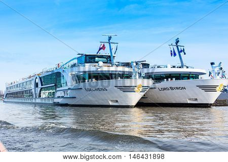 Amsterdam, Netherlands - April 1, 2016: Two cruise river ships Edelweiss and Lord Byron in Amsterdam, Holland