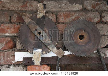 old circular saw on a shabby brick wall