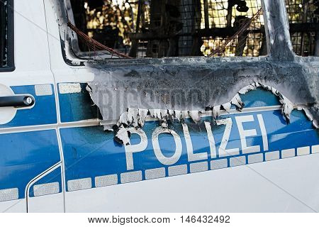 Burnt-out car after an arson attack on police cars in the center of Magdeburg