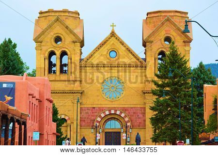 August 28, 2016 in Santa Fe, NM:  Cathedral Basilica of St Francis of Assisi built between 1869 and 1887 and is the main Catholic Cathedral in the center of town and where locals and tourists can worship taken in Santa Fe, NM