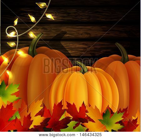 autumn leaves cozy patio lights and three orange pumpkins on wooden texture