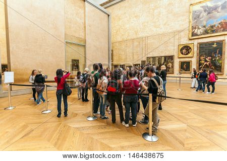 Paris, France - April 8, 2011: Students Walking Inside The Louvre Museum Near Mona Lisa Portrait