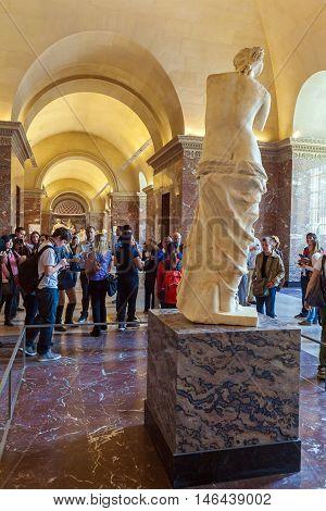 Paris, France - April 8, 2011: Visitors Walking Inside The Louvre Near Venus De Milo Statue