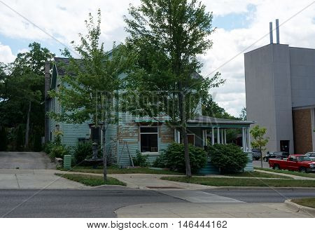 PETOSKEY, MICHIGAN / UNITED STATES - AUGUST 5, 2016: A large home at the corner of Mitchell and Division Streets near downtown Petoskey.
