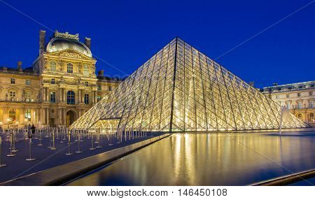 Paris France-Septembre 08 2016 : The Louvre Pyramid based in the main courtyard ( cour Napoleon )of the Louvre Palace in Paris.It serves as the main entrance to the Louvre museum.