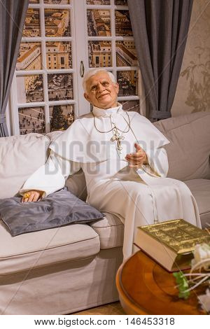 KRAKOW, POLAND - FEB 9, 2016: Pope Benedict XVI wax figure of Polonia Wax Museum at Main Market Square. The Wax Museum was opened in 2016, inspired by the organization in Krakow World Youth Day.