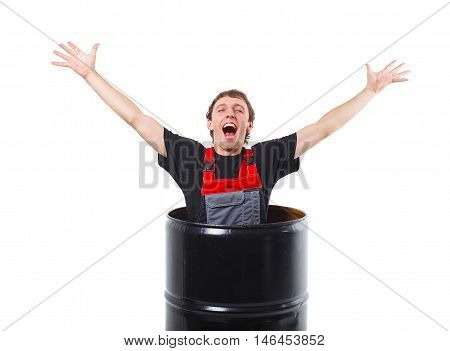 cheerful repairman isolated on white background. worker held up his arms in delight and shouts of joy. a young man climbs out of a black tube or barrel. the concept of successful completion of repair