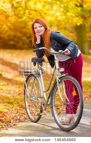 Ginger Hair Girl With Her Bike In The Park.