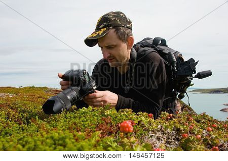 photographer at work on the Barents Sea