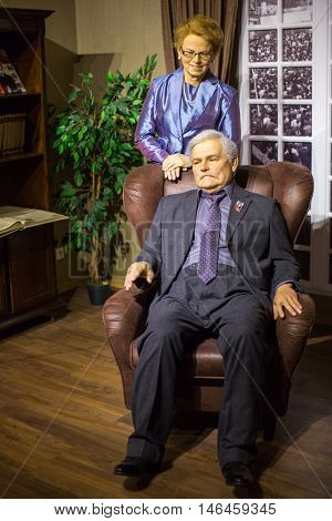 KRAKOW, POLAND - FEB 9, 2016: Lech Walesa and Danuta wax figures of Polonia Wax Museum at Main Market Square. The Wax Museum was opened in 2016, inspired by the organization in Krakow World Youth Day.